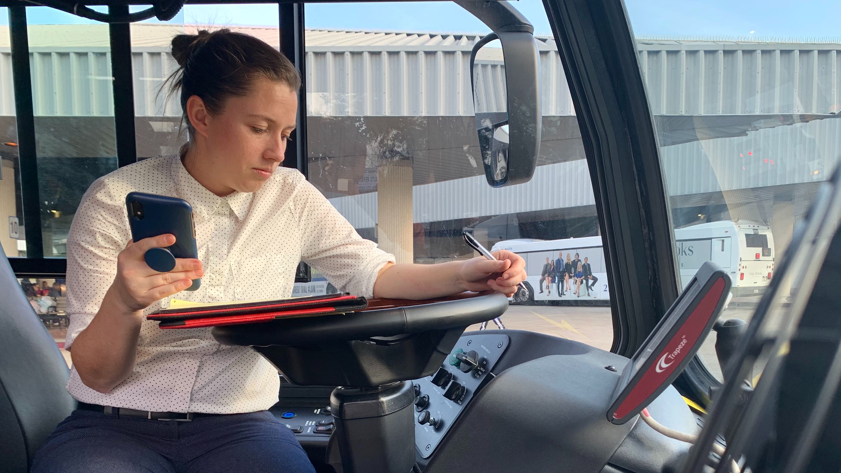 A CTE associate tests a fast charging system to review and monitor the infrastructure supporting the entity's electric buses